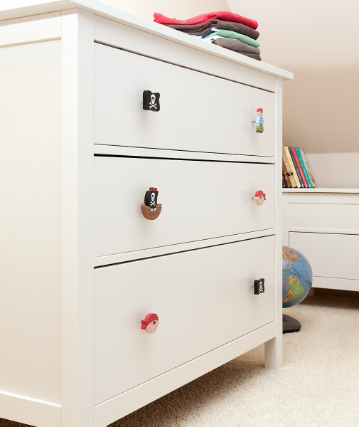 IKEA hacks: Switch the drawer knobs on an IKEA Hemnes chest of drawers to create a themed piece of furniture for a nursery or kids room. IKEA Hemnes chest of drawers with drawer knobs changed to be pirate themed drawer knobs.