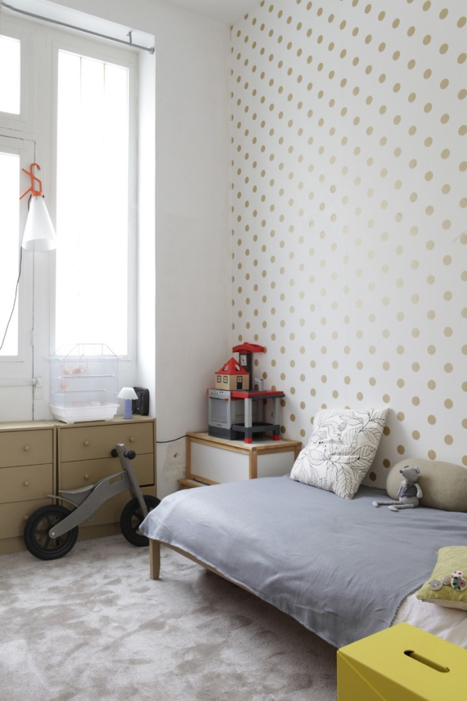 Polka dot wallpaper for kids room or nursery. Soft gold polka dot on white wallpaper